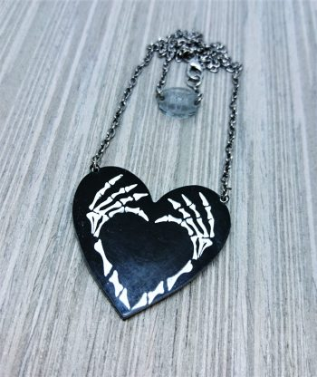 skeleton hands heart necklace brooch by beams and bobbins